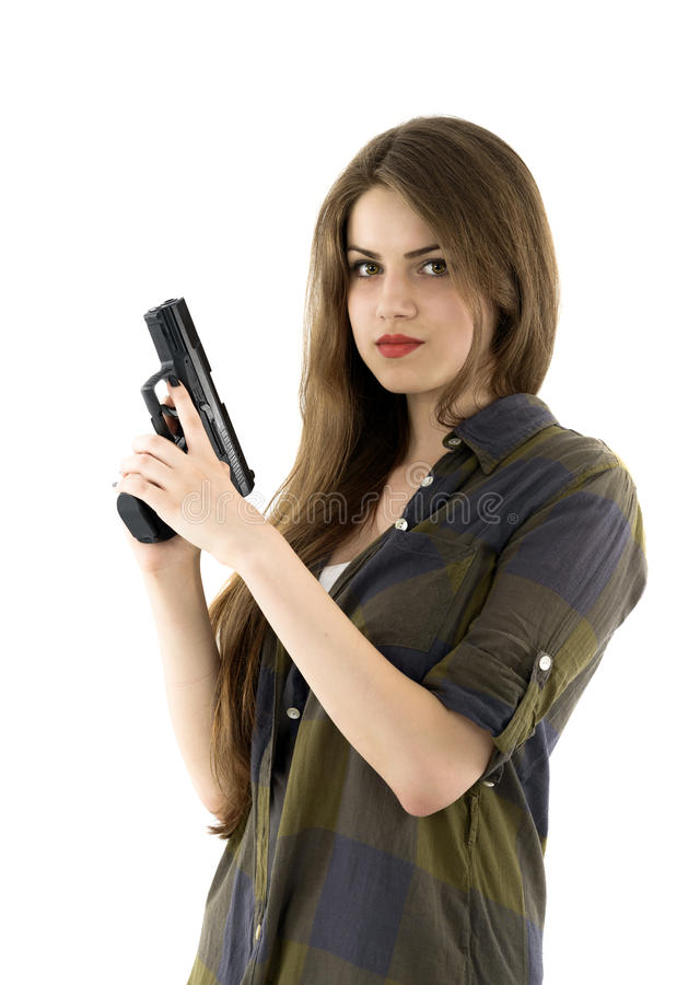 Beautiful woman holding a gun on white background stock images