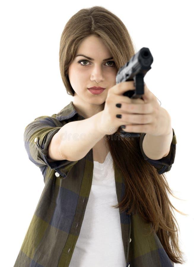 Beautiful woman holding a gun on white background stock photo