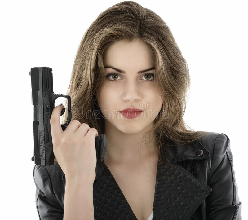 Beautiful woman holding a gun on white background stock photos