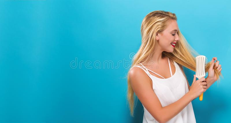 Beautiful woman holding a hairbrush royalty free stock photo