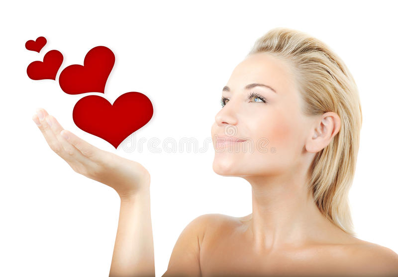 Beautiful woman holding hearts royalty free stock image