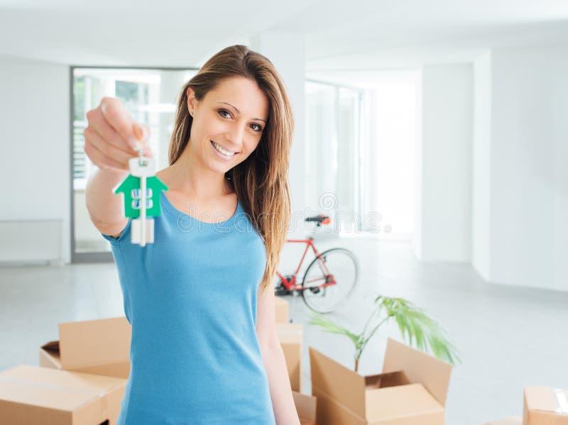 Beautiful woman holding house keys stock photos