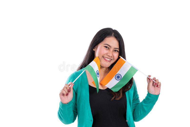 Beautiful woman holding india flag. Beautiful young women with smile holding india flag royalty free stock image