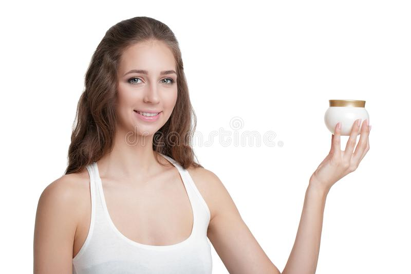 Woman holding jar of cream royalty free stock photography