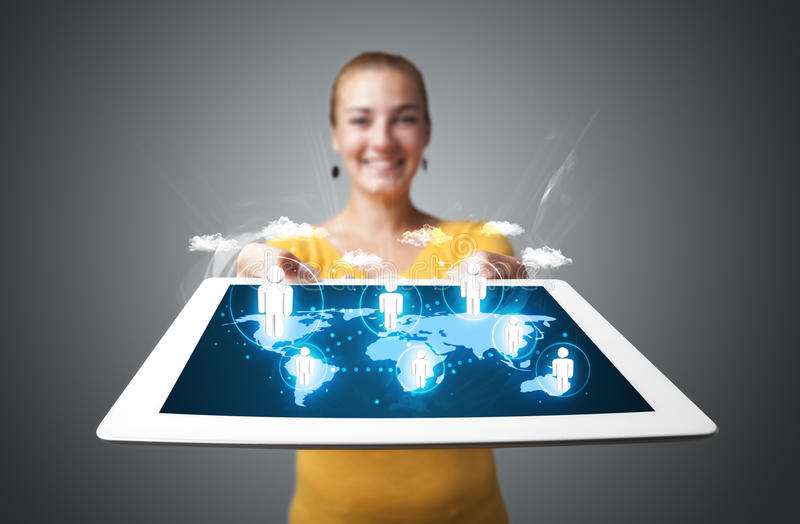 Beautiful Woman Holding Modern Tablet With Social Icons Stock Photo
