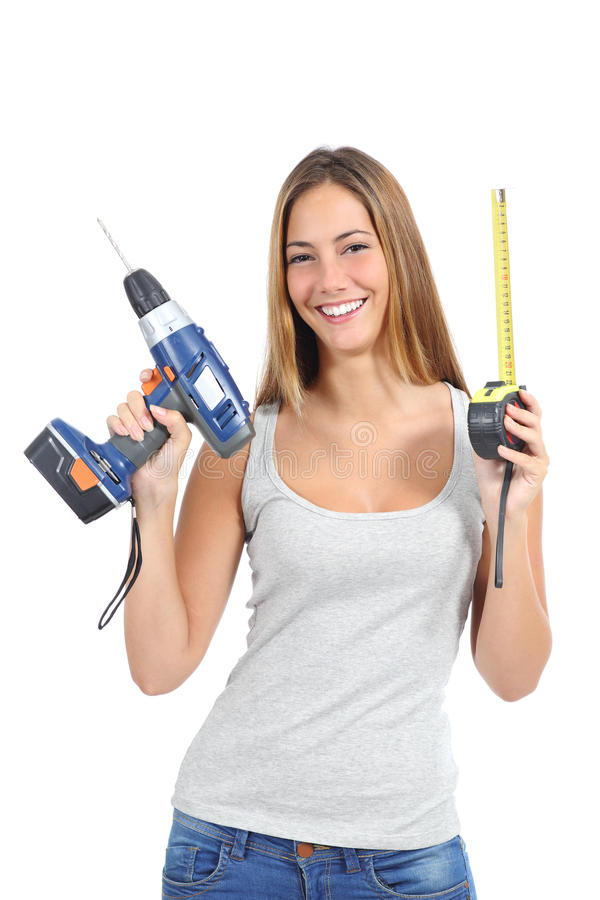 Beautiful woman holding a power drill and a tape measure stock images