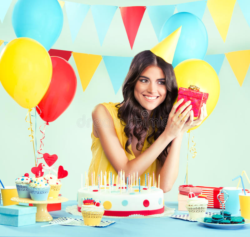 Beautiful woman holding a present at her birthday stock photo