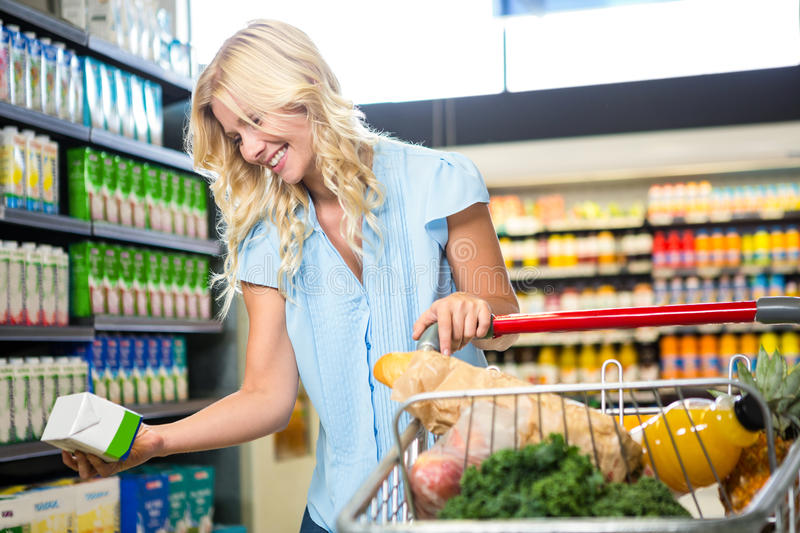 Beautiful woman holding product stock photography