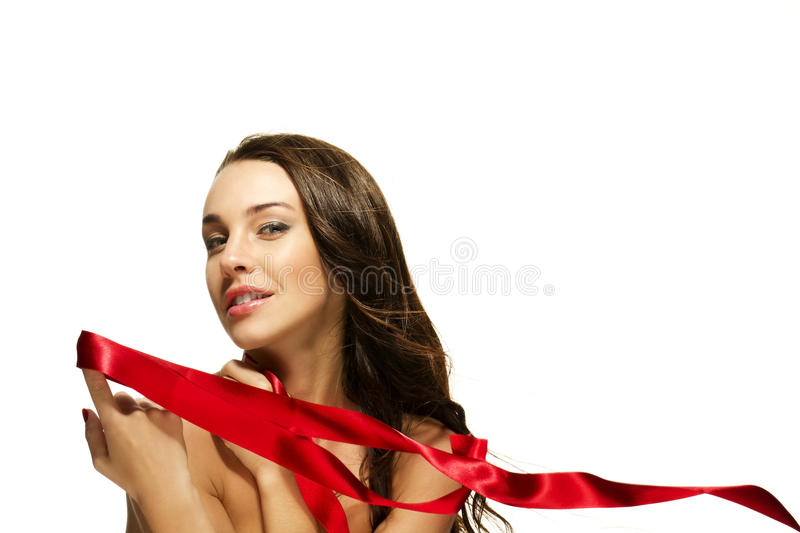 Beautiful woman holding red ribbon with her finger royalty free stock photography