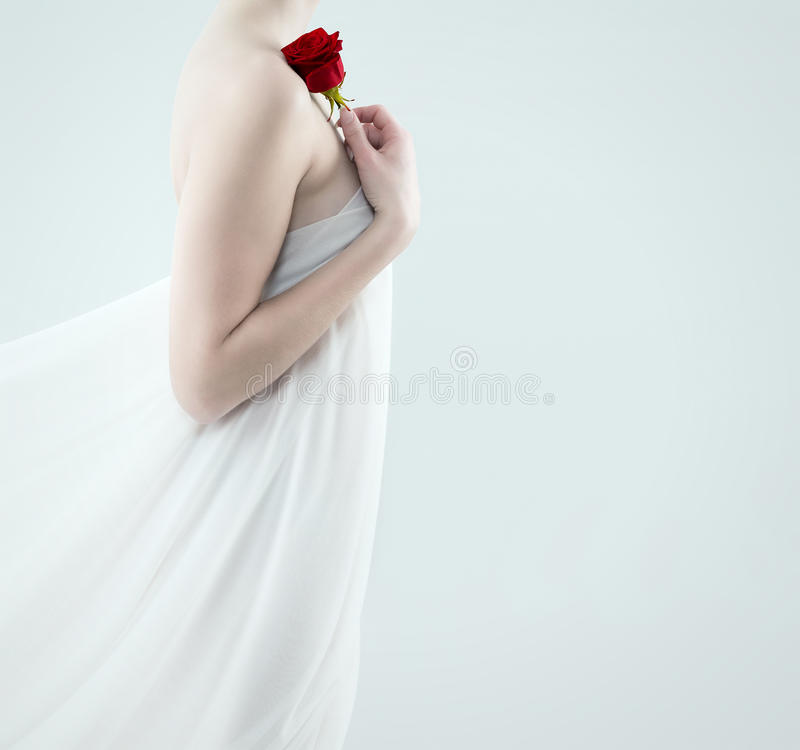Beautiful woman holding red rose royalty free stock photography