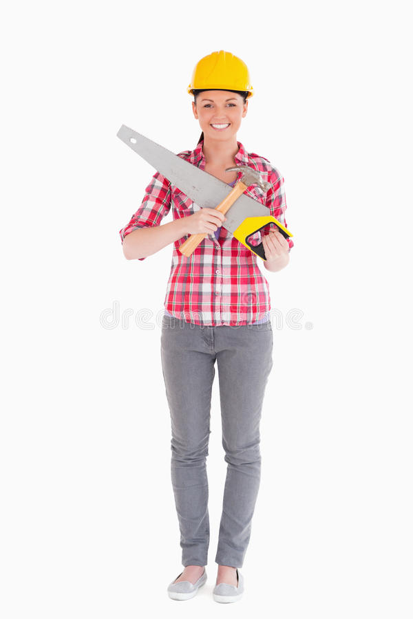 Beautiful Woman Holding A Saw While Standing Stock Photos