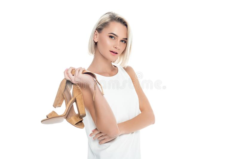 beautiful woman holding stylish sandals, royalty free stock images