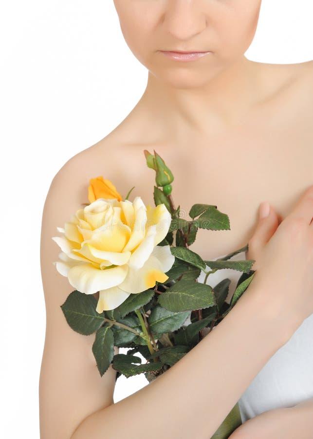 Beautiful woman holding yellow rose plant stock photos
