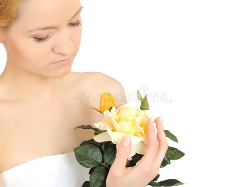 Beautiful woman holding yellow rose plant stock photo