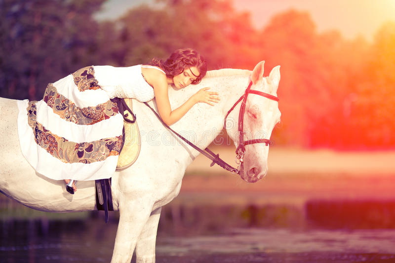 Beautiful woman on a horse. Horseback rider, woman riding horse. Young woman on a horse. Horseback rider, woman riding horse on beach royalty free stock photos