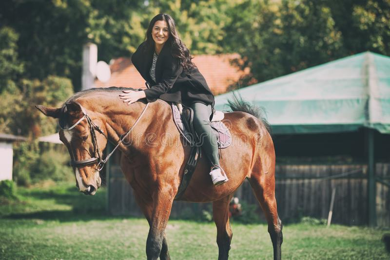 Beautiful woman on horseback, having fun with horse on ranch royalty free stock images