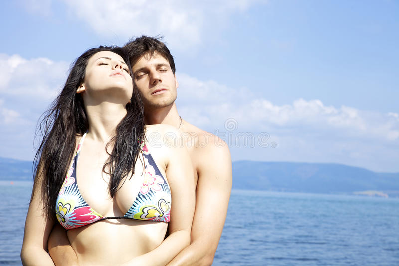 Download Beautiful Woman Hugged By Handsome Man In The Water Stock Photo - Image: 31384324