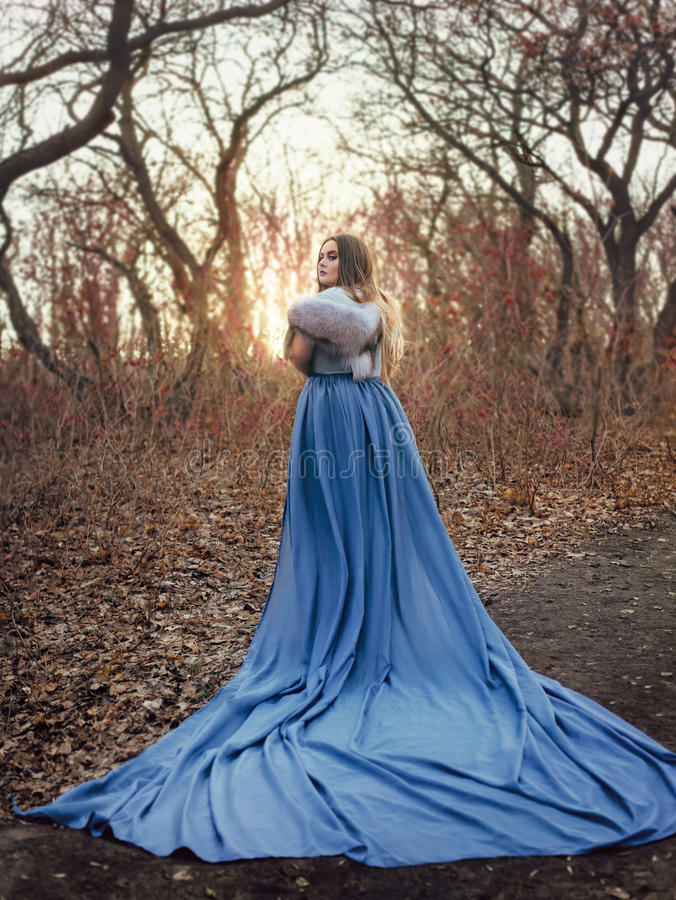 Free Beautiful Woman In A Blue Raincoat Royalty Free Stock Photography - 90832547