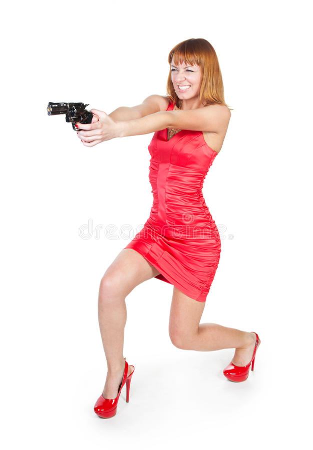 Free Beautiful Woman In A Red Dress With A Gun Royalty Free Stock Photography - 19317987