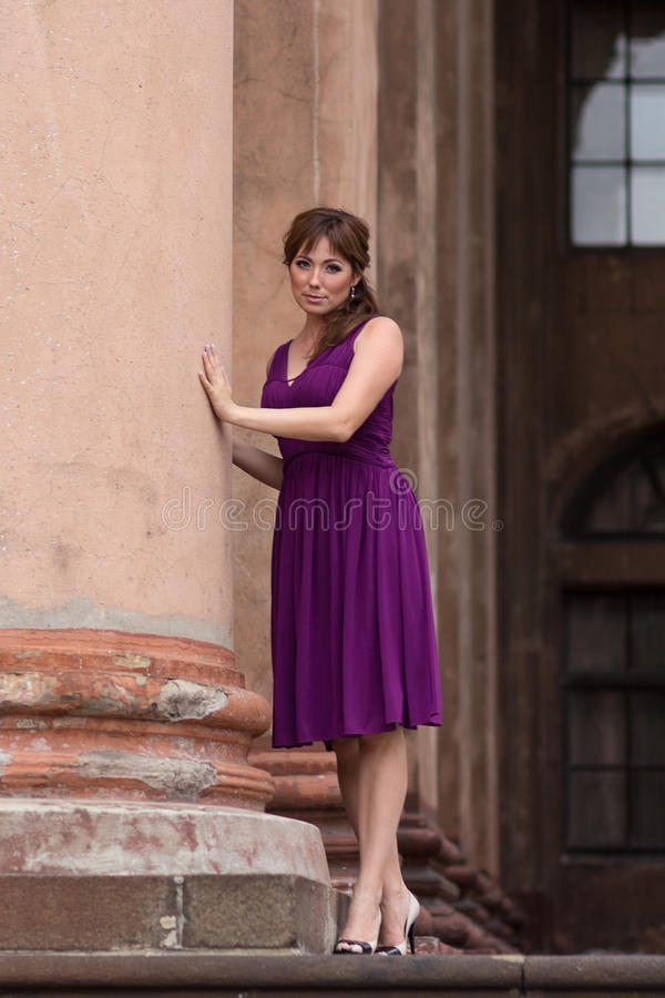 Free Beautiful Woman In Purple Dress Near The Column Stock Image - 87879691
