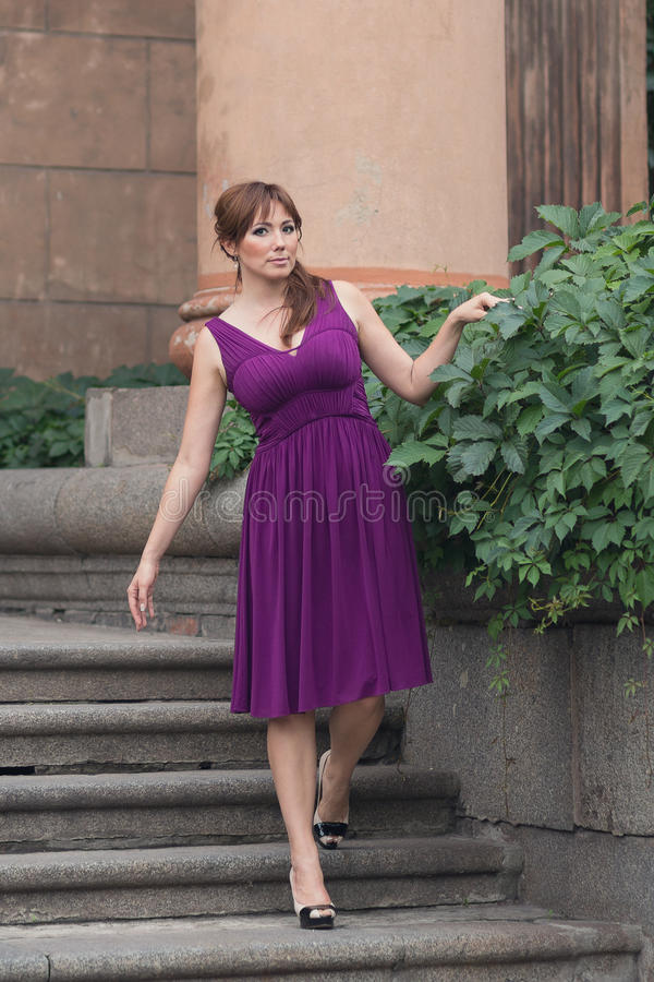 Free Beautiful Woman In Purple Dress Near The Column Royalty Free Stock Photography - 90319747