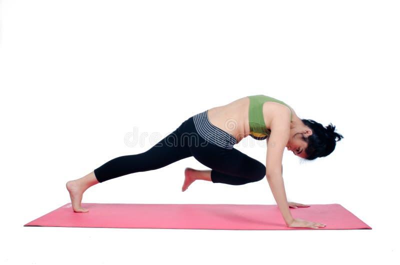 Beautiful woman indoor exercising using pink yoga mat. Photo of Beautiful woman indoor exercising using pink yoga mat royalty free stock photography