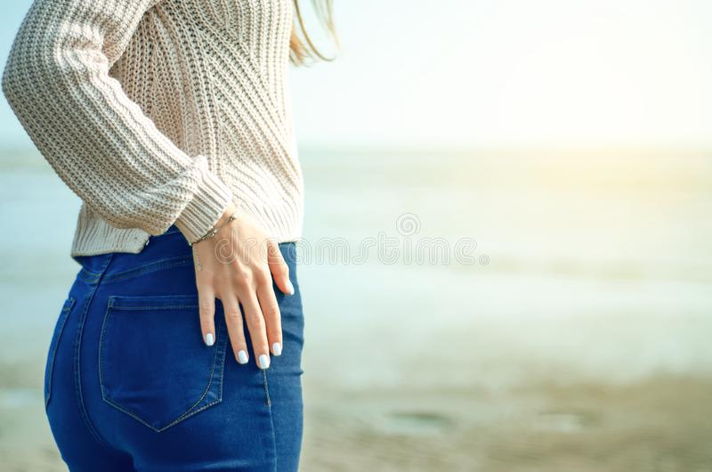 Beautiful woman jeans sweater stock photos