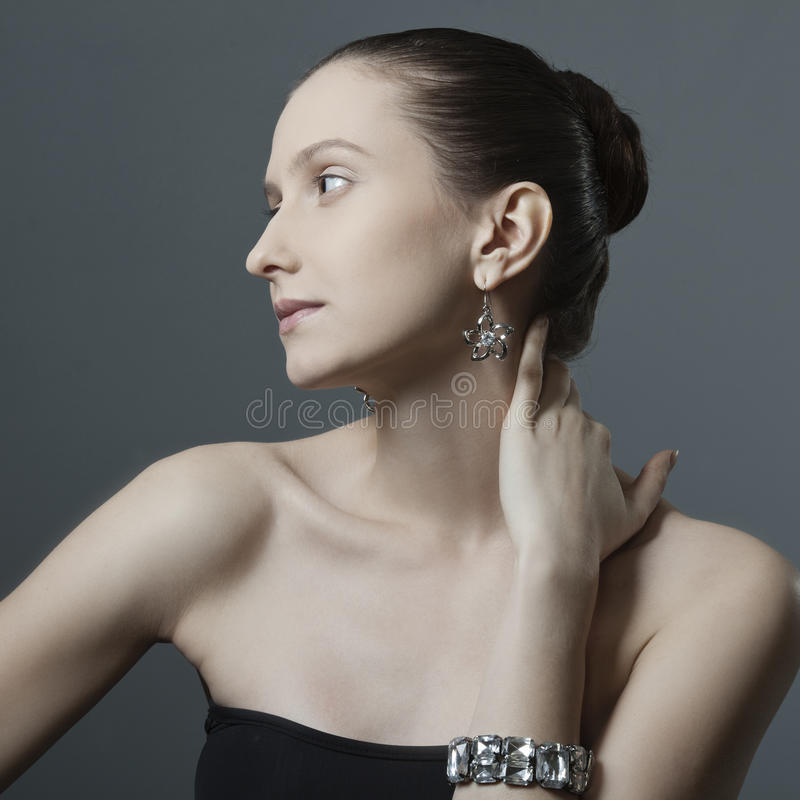 Beautiful woman with jewelry royalty free stock photography