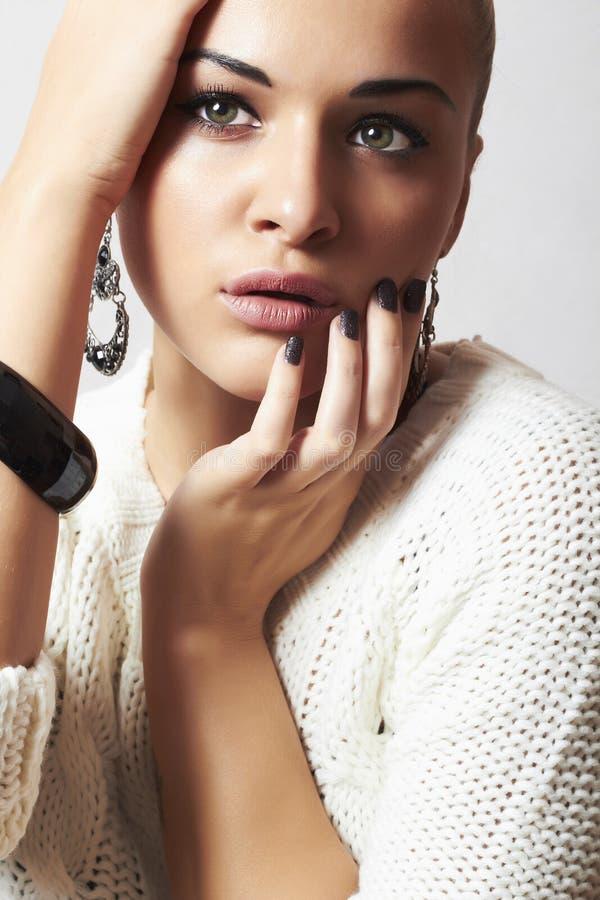 Beautiful woman.Jewelry and Beauty.girl.ornamentation.liquid sand manicure.hairless