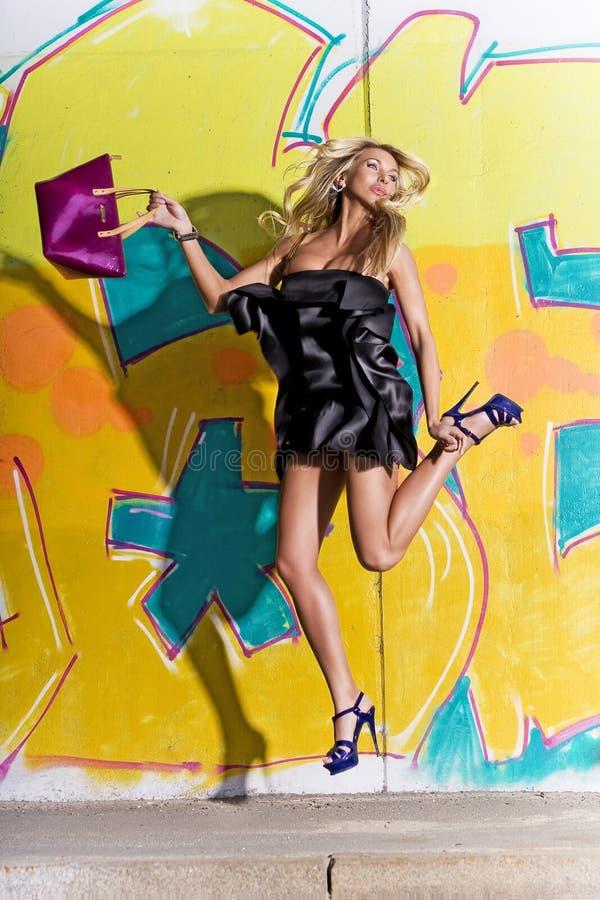 Beautiful woman jump stock photography