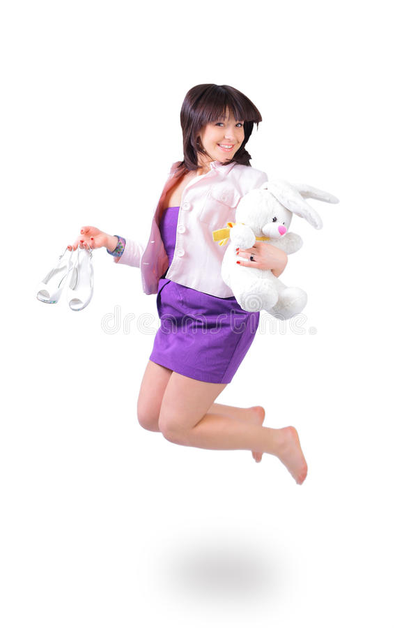 Download Beautiful  Woman Jumping In Joy With Plush Rabbit Stock Images - Image: 22418934