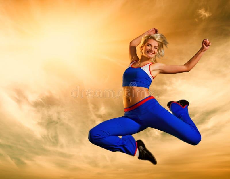 Beautiful Woman Jumping Outdoors Stock Photography