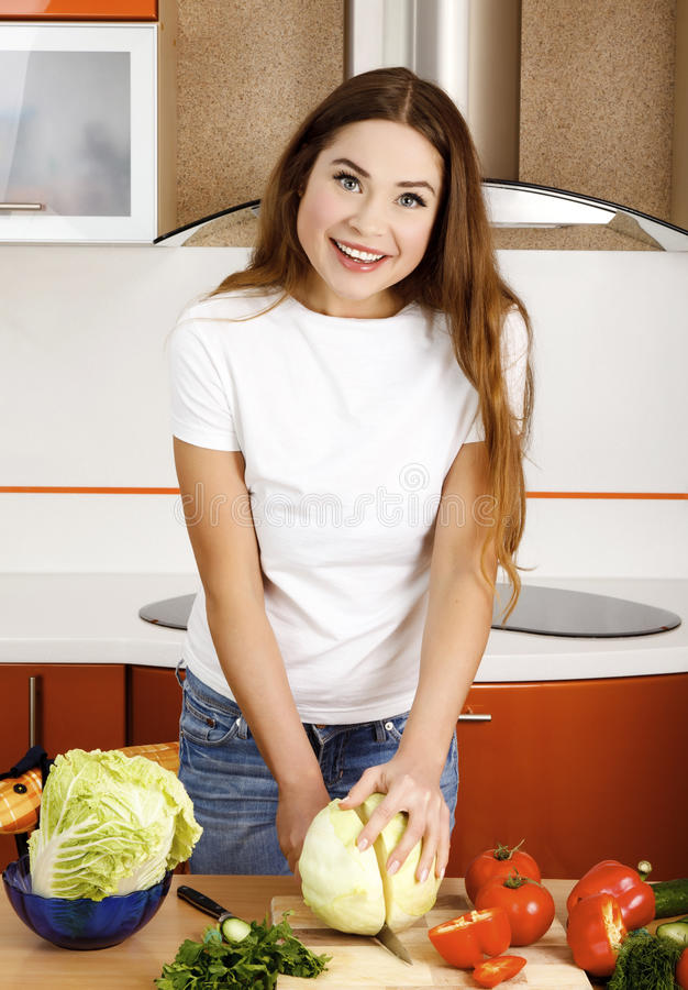 Beautiful Woman In The Kitchen Royalty Free Stock Images