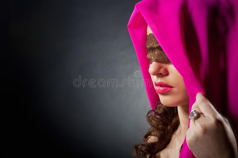Beautiful woman with a lace on her eyes stock photos