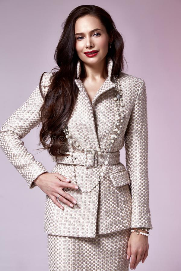 Beautiful woman lady spring autumn collection glamor model business office fashion clothes wear casual style beige color suit. Blouse jacket skirt pretty face stock images