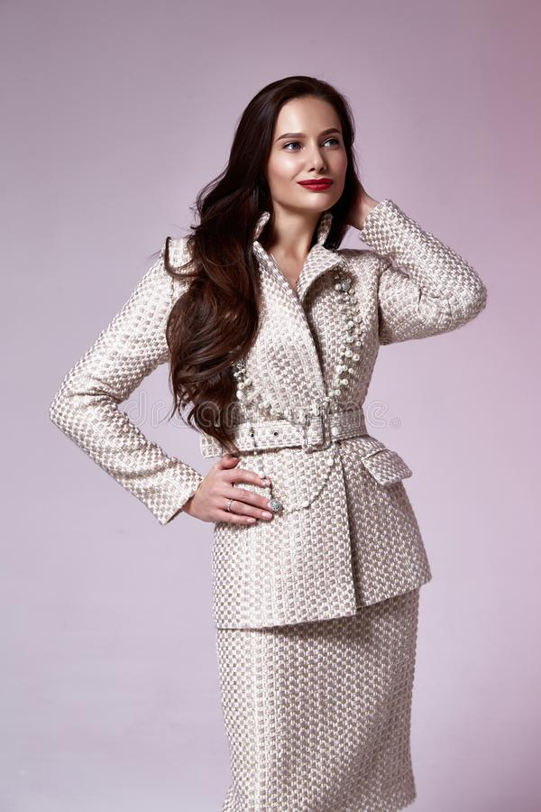 Beautiful woman lady spring autumn collection glamor model business office fashion clothes wear casual style beige color suit. Blouse jacket skirt pretty face royalty free stock photography