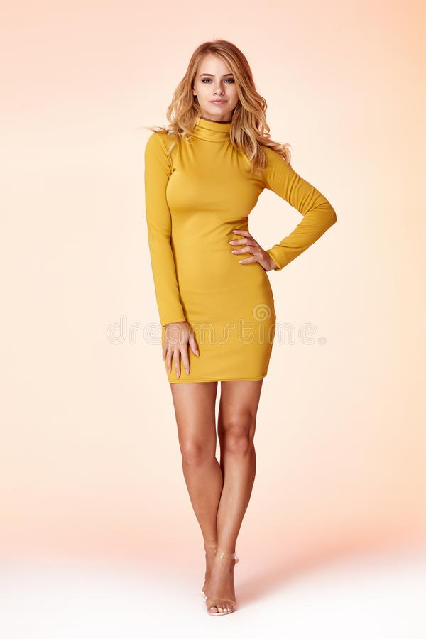Beautiful woman lady spring autumn collection glamor model business office fashion clothes wear casual style yellow color suit royalty free stock photo