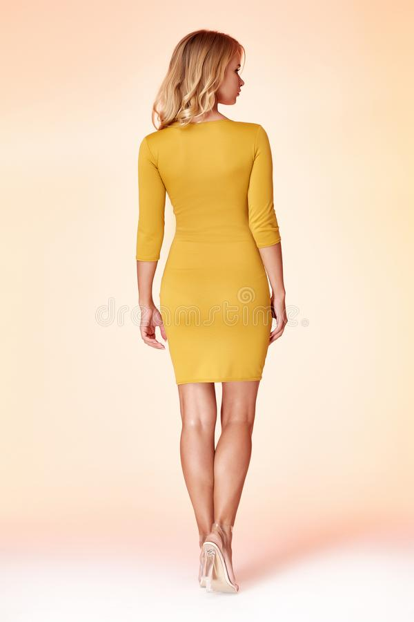 Beautiful woman lady spring autumn collection glamor model business office fashion clothes wear casual style yellow color suit. Blouse jacket skirt black pretty stock photo