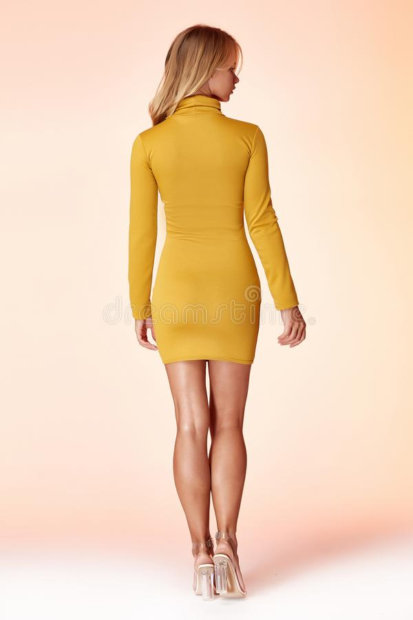 Beautiful woman lady spring autumn collection glamor model business office fashion clothes wear casual style yellow color suit. Blouse jacket skirt black pretty royalty free stock image