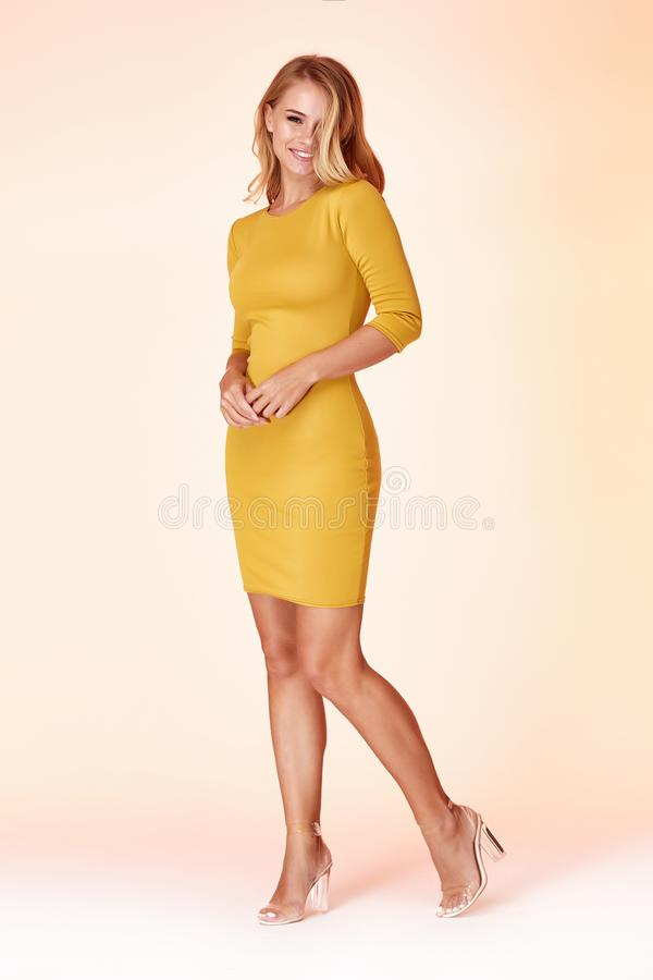 Beautiful woman lady spring autumn collection glamor model business office fashion clothes wear casual style yellow color suit. Blouse jacket skirt black pretty royalty free stock images