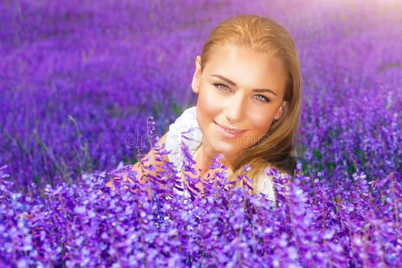 Beautiful woman in lavender field stock photo