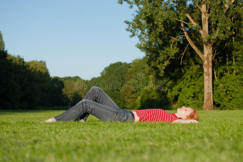 A Beautiful Woman Laying In The Park Royalty Free Stock Images