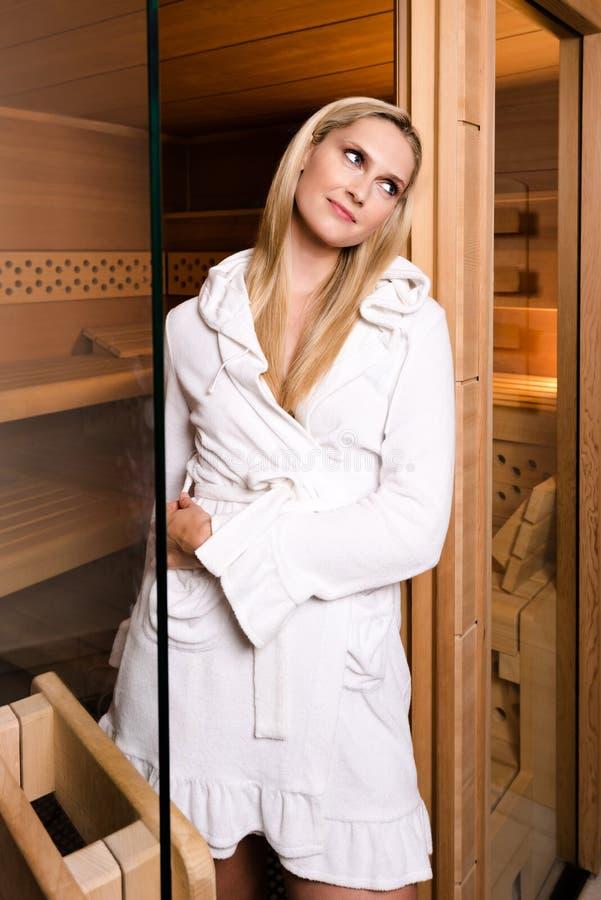 Beautiful woman leaving sauna stock photography
