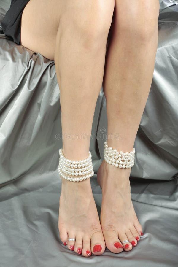 Beautiful Woman   Legs Over Satin Fabric Stock Photography