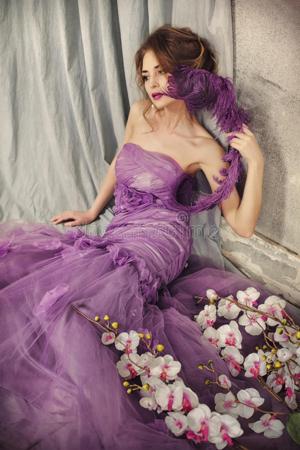 Beautiful woman in a lilac dress. royalty free stock photos