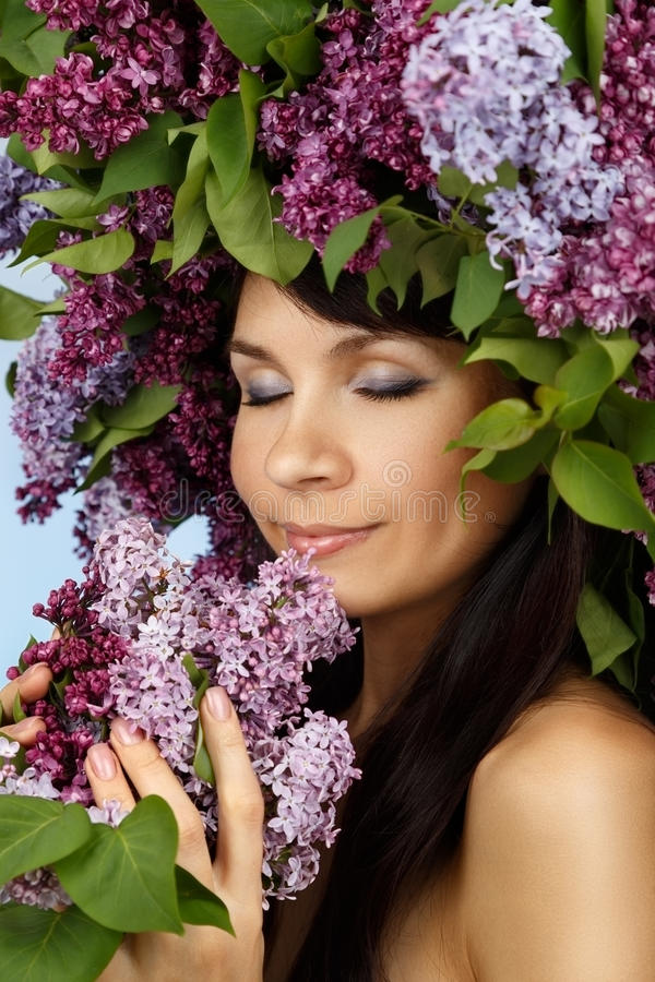 Beautiful woman with lilac flowers royalty free stock photo