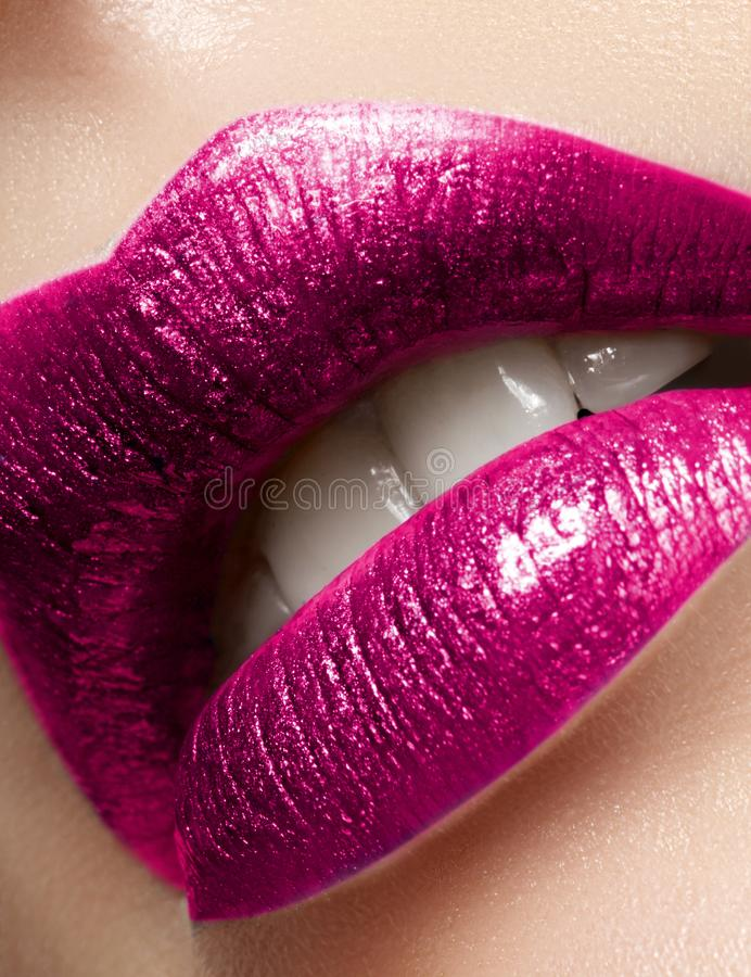 Beautiful Woman Lips with Fashion Glitter Metalic Lipstick Makeup. Christmas Or Valentine Day Make-Up. Beauty Lip Visage. Passionate kiss. Female Open Mouth stock images