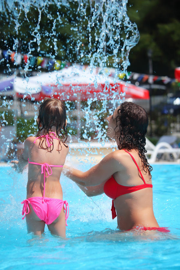 Download Beautiful Woman And Little Girl Bathes In Pool Stock Image - Image: 13021675