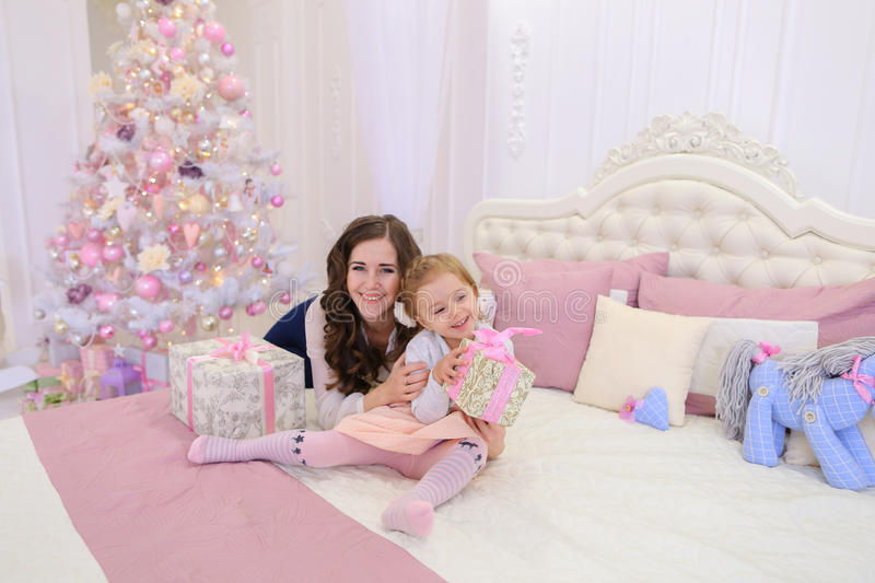Beautiful woman and little girl, mother and daughter in good moo stock photos
