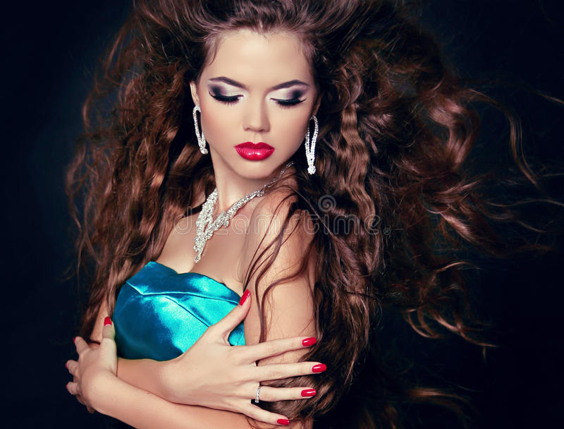 Beautiful woman with long brown blowing hair. Fashion girl with stock image
